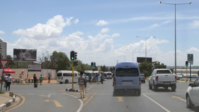 a tracking shot of a city street with a traffic light in soweto - soweto stock videos & royalty-free footage