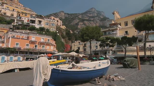 tracking shot of a fishing boat on positano beach, amalfi coast, italy - amalfi stock videos and b-roll footage