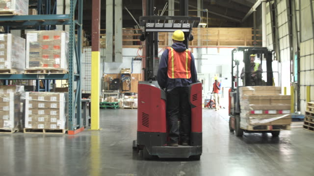 tracking shot of a forklift driver - medium group of people stock videos & royalty-free footage