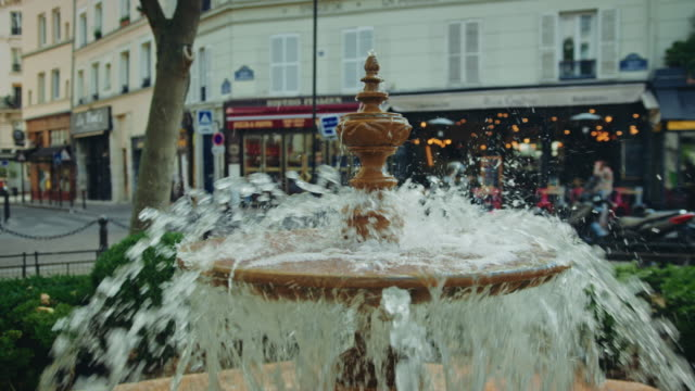 Tracking shot of a fountain in the Mouffetard street area