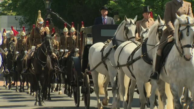 tracking shot of a horse drawn carriage passing down castle hill during the rehearsal for the wedding of prince harry and meghan markle in windsor - windsor england stock videos and b-roll footage