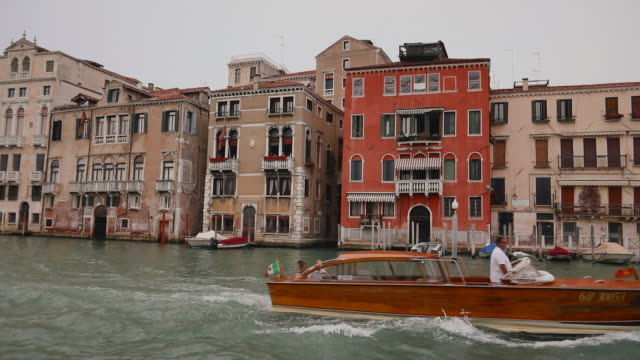 tracking shot of a luxury water taxi in grand canal, venice, italy - travel stock videos & royalty-free footage