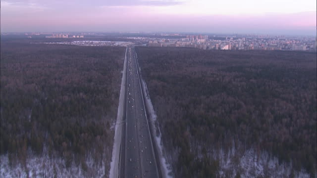 tracking shot of a major road leading to moscow, russia. - major road video stock e b–roll