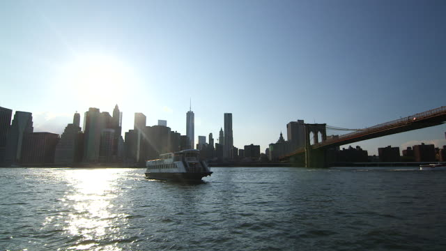 Tracking shot of a 'NY Waterway' ferry approaching dock on the East River.