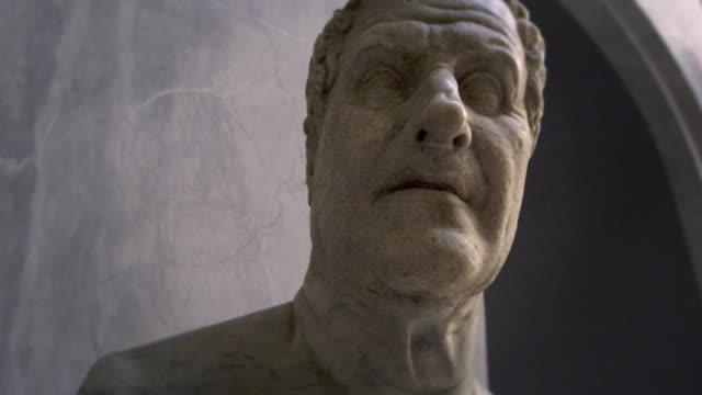 tracking shot of a statue head - sculpture stock-videos und b-roll-filmmaterial