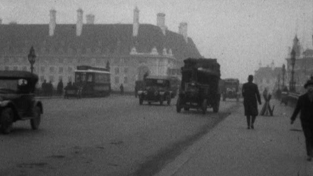 tracking shot of a steam powered truck driving on a wide street license plate 1583 and words printed on the side rickett cocnerell mark lane london... - 1925 stock videos & royalty-free footage