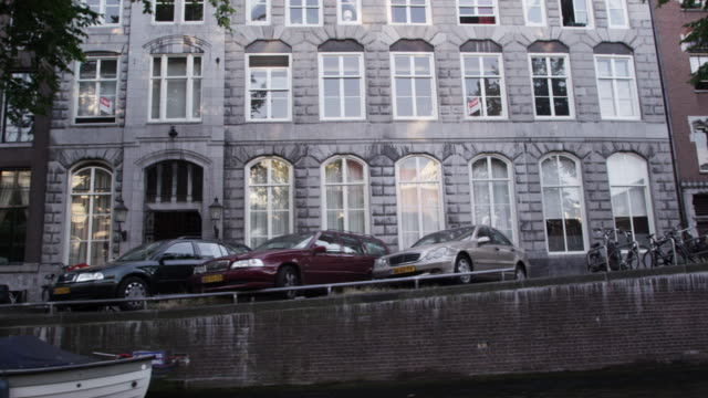 tracking shot of a street in utrecht in the netherlands - utrecht stock videos & royalty-free footage