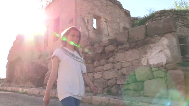 tracking shot of a teenage girl walking with the sun behind her - only teenage girls stock videos & royalty-free footage