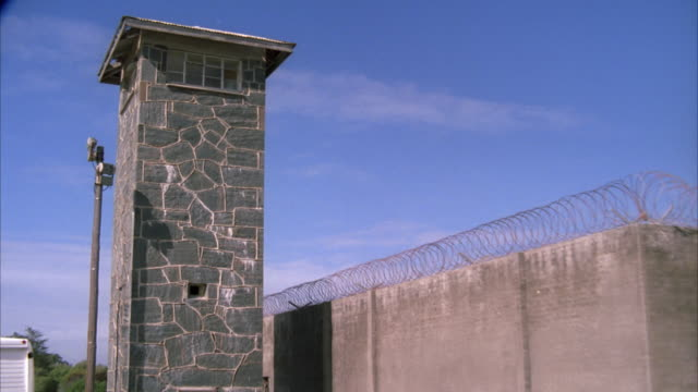 Tracking shot of a the prison watch tower on Robben Island