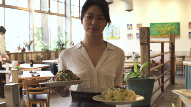 tracking shot of a waitress serving food - plate stock videos and b-roll footage