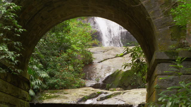tracking shot of a waterfall through a sone arch. - 2013 stock videos & royalty-free footage