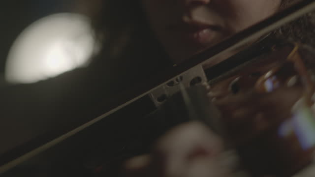 tracking shot of an arab girl playing the violin. - music stock videos & royalty-free footage