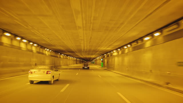 tracking shot of an expressway underpass - tracking shot stock videos & royalty-free footage