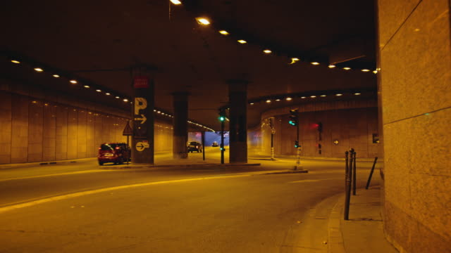 tracking shot of an underpass and underground parking lot entrance - parking stock videos & royalty-free footage