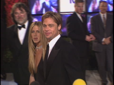 tracking shot of aniston and pitt walking through crowd - brad pitt actor stock videos & royalty-free footage