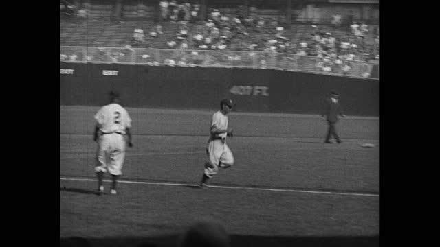 tracking shot of baseball player hitting, running bases during game, yankee stadium, new york city, new york, usa - baseball strip stock videos & royalty-free footage