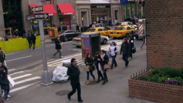 tracking shot of bleecker street in nyc. - street name sign stock videos & royalty-free footage