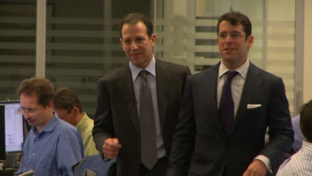 A tracking shot of Blue Mountain Capital Management CEO Andrew Feldstein and Co Founder Stephen Siderow chatting with each other as they walk through...