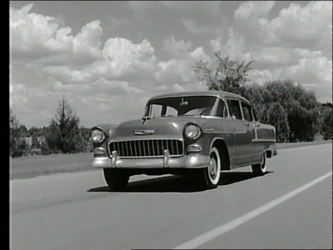 b/w 1955 tracking shot of car driving on country road / chevrolet - 1955 stock videos & royalty-free footage