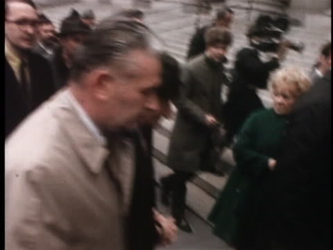 tracking shot of carlo gambino walking with a man on either side of him. he is in handcuffs and wearing a black hat and overcoat. cut to tracking... - organised crime stock videos & royalty-free footage
