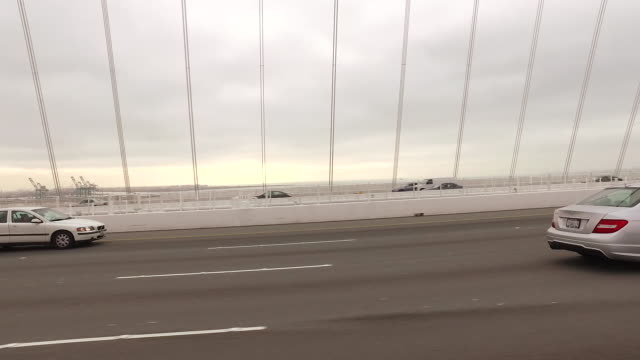 tracking shot of cars moving along the san francisco bay bridge. - land vehicle stock videos & royalty-free footage