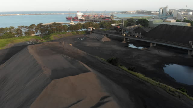 tracking shot of coal waiting to be loaded onto a ship - coal stock videos & royalty-free footage