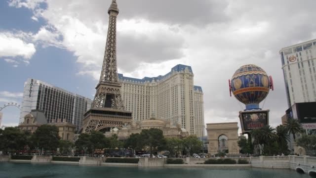 tracking shot of eiffel tower of paris hotel and casino, the strip, las vegas boulevard, las vegas, nevada, usa, north america - paris las vegas stock videos & royalty-free footage