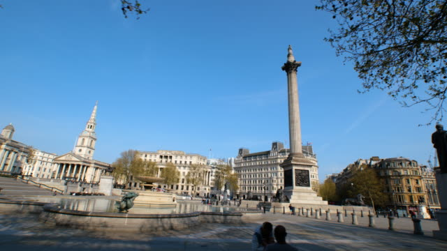 tracking shot of empty trafalgar square, nelson's column and lions during lockdown for coronavirus pandemic in london, england, uk, on thursday,... - sky stock videos & royalty-free footage
