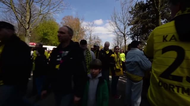 tracking shot of fans walking towards stadium signal iduna park general view at signal iduna park on april 20 2013 in dortmund federal republic of... - borussia dortmund stock videos and b-roll footage
