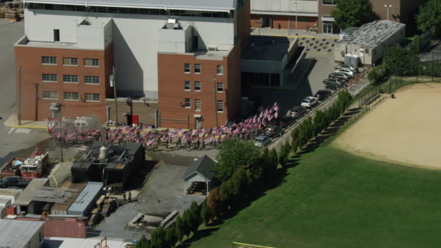tracking shot of firefighter trainees jogging with flags of the united states of america in their hands at the fire department of the city of new york training center - fire department of the city of new york stock videos and b-roll footage