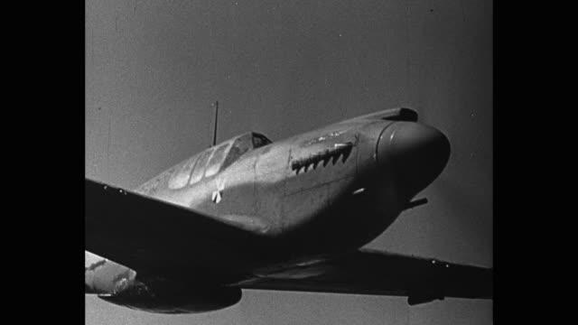 cu tracking shot of german fighter plane flying - ドイツ国防軍 空軍点の映像素材/bロール