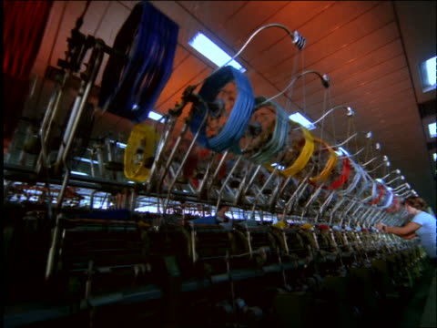 tracking shot of looms + brightly colored threads in textile factory / brazil - textile mill stock videos & royalty-free footage