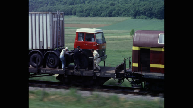 1968 - tracking shot of men fighting on moving train - stunt person stock videos & royalty-free footage