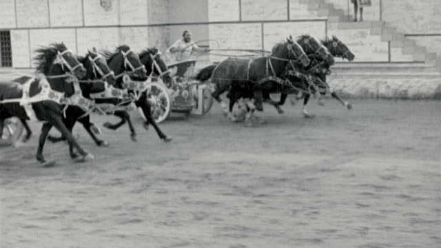 b/w tracking shot of men riding chariots pulled by horses in race / ben-hur (1925) - ancient history stock videos & royalty-free footage