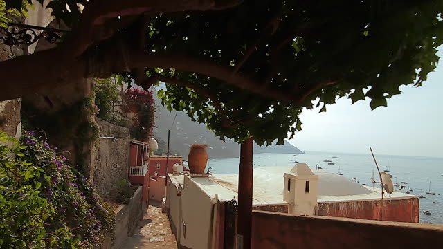Tracking shot of narrow street and houses in Positano, Amalfi Coast, Italy