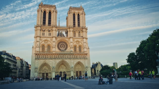 vidéos et rushes de tracking shot of notre-dame de paris at sunset - dolly shot