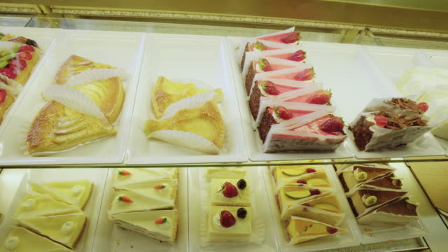 Tracking Shot of Pastries in Display Case