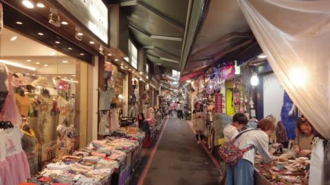 ms tracking shot of people shopping in taipei, taiwan - taipei stock videos & royalty-free footage