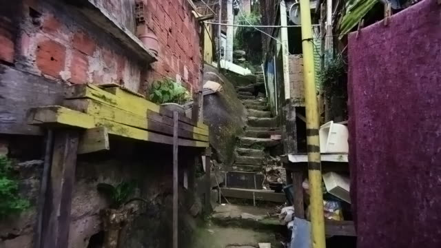 tracking shot of shanties along the stairs in a favela in rio de janeiro, brazil - slum stock videos & royalty-free footage