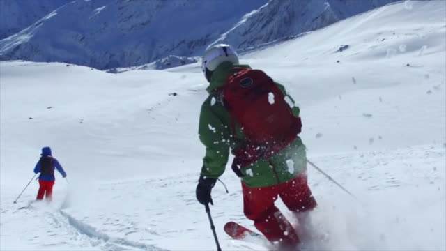 pov tracking shot of skiing on snow covered mountains. - slow motion - russia stock videos & royalty-free footage