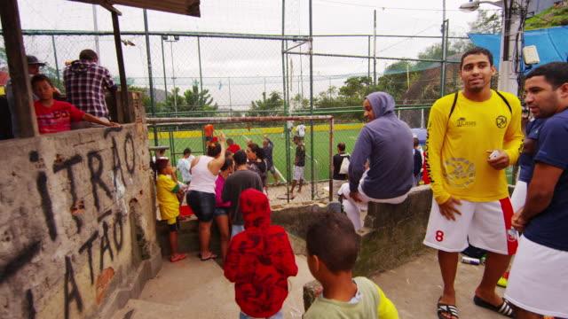 RIO DE JANEIRO, BRAZIL - JUNE 23: Tracking Shot of Soccer Players Preparing to Play