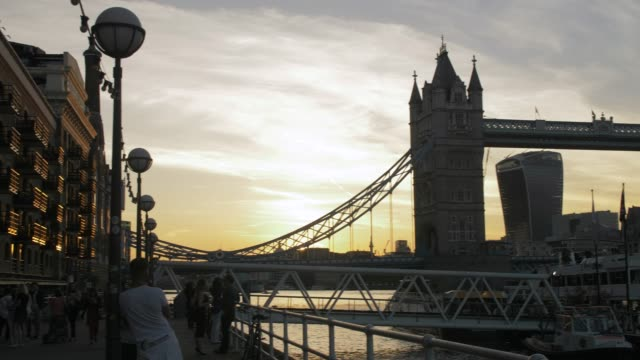Tracking shot of Sunset at Tower Bridge from Butlers Wharf, Southwark, London, England, United Kingdom, Europe