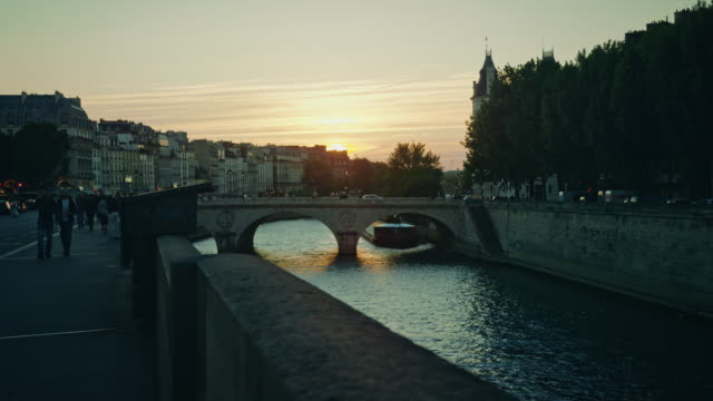 tracking shot of the banks of the seine river at sunset - river seine stock videos & royalty-free footage