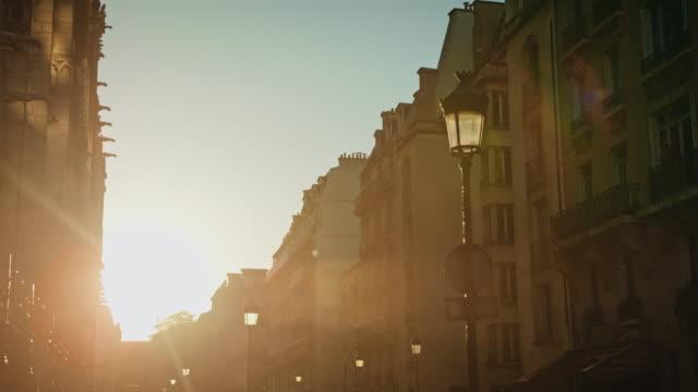 vidéos et rushes de tracking shot of the north side of notre-dame de paris at sunset - crépuscule