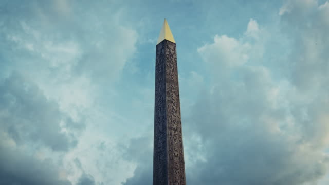 tracking shot of the place de la concorde obelisk at sunset - obelisk stock-videos und b-roll-filmmaterial