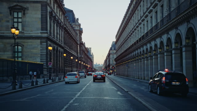 Tracking shot of the Rue de Rivoli, at dusk