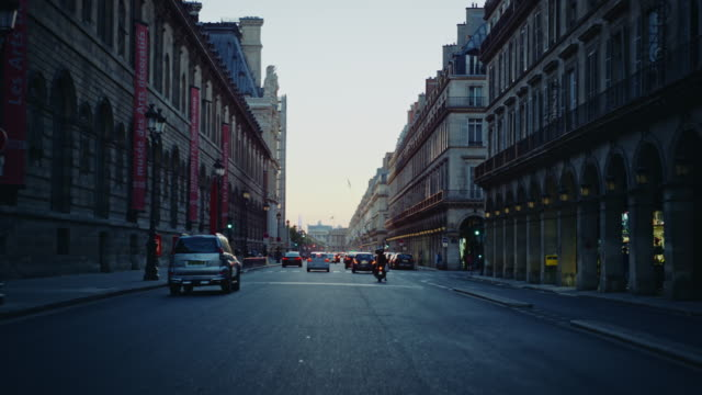 tracking shot of the rue de rivoli, at dusk - street stock-videos und b-roll-filmmaterial