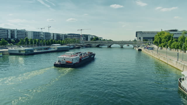 tracking shot of the seine river near bercy area - river seine stock videos & royalty-free footage