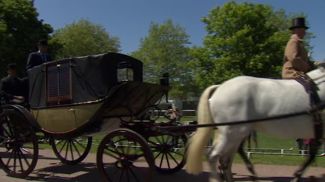 tracking shot of the wedding procession travelling down the 'long walk' towards windsor castle during the rehearsal for the wedding of prince harry... - prince harry stock videos and b-roll footage
