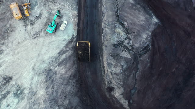 tracking shot of truck working in coal mine - quarry stock videos & royalty-free footage